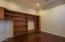 Note: Den wood floors have been refinished into a lighter finish. Built in cabinets included!