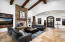 Floor to ceiling stone gas fireplace.Vaulted hand-hewn beam ceiling.