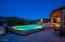 Heated pool with inside negative edge.