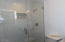 GORGEOUS GLASS SHOWER ENCLOSURE IN MASTER BATHROOM