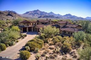 Featuring a long meandering driveway, this outstanding Hacienda-style Estate home is located on one of the largest lots in DC Ranch.