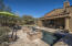 Grassy area, large pool deck, water features, & covered patio