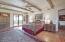 Master Bedroom with Built-ins wet bar- under counter refrigerator -