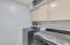 Main floor laundry room. Laundry shoot in cabinet.