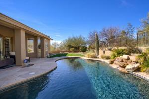 Extremely private corner lot backing to natural open desert.