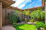 Lush Front Courtyard with Turf