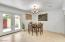 Spacious dining area with direct access to the kitchen