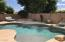 Built-in pool lounge cove with hole for patio umbrella