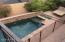 Off the interior courtyard is a fenced pool.