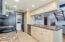 Kitchen: Custom Cabinets, Granite Countertops, title flooring, recessed lighting.