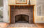This fireplace has special Motawi handmade tiles, oak mantel & gas log fixture.