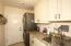 Stacked washer/dryer, utility sink, custom cabinets and direct access to garage.