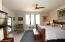 Master bedroom w/upgraded lighting, ceiling fan, windows, doors & overlooks resort backyard!