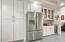 Wine fridge and a few select custom glass door cabinets