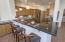 Open and Spacious Kitchen with Breakfast Bar. Opens to Great Room and Dining.
