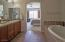 Ensuite to the Bedroom is spa bath with deep soaker tub, separate shower, dual vanity and large walk-in closet