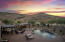 Backyard overview to the SW shows the mountain views, ramadas, pool and spa.