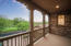 This balcony is south facing connecting to guest bedrooom #1 and overlooking the Park.