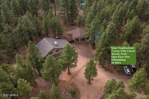 Amazing home on 5.2 acre, fully fenced lot with lush Ponderosa Pines surrounding the property.
