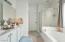 Master bathroom shower, tub and walk in closet