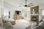 Great room with vaulted ceilings and stone travertine flooring
