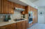 the length of the kitchen for ample storage