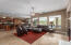 Spacious living area with wall to wall windows overlooking the yard and views