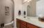Generous vanity in the 2 piece hallway powder room