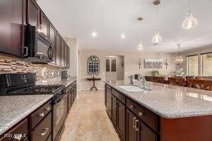 Spacious Kitchen with Oversized Island and Upgraded Backsplash