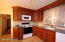 This kitchen has been totally updated! Gorgeous countertops and soft close drawers. Loads of space!