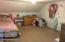Carpeted playroom, excersice room, or 4th bedroom