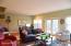 Living room with doors to deck