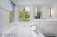 First master bathroom has a tub