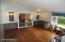 Large 15' x 15' Living room with Hardwood floors & Picture window