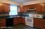 Spacious kitchen with oak cabinets.