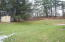 Partially cleared & wood yard.