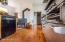 TWO DISHWASHERS, A LARGE WOODSTOVE, AND THE BACK STAIRWAY BEYOND