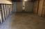 Full basement with three unfinished rooms and laundry room
