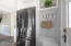 Kitchen with coat/boot/shoe storage area