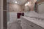 Totally updated Primary full bath. Granite double bowl counters. 230V Envi silent heater.