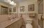 Hallway full bath with bath/shower, tiled floor.