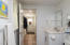 The mudroom leads to the laundry and first floor bathroom.