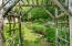 The entry garden path leads to a cupola.