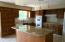 Custom wood cabinets, granite counter tops & island. Fully applianced.