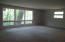 Living Room overlooking wooded lot