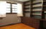 Bedroom 2 with hardwoods and built ins