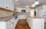NOTE: Center work island, travertine backsplash - DOUBLE ovens and coorktop