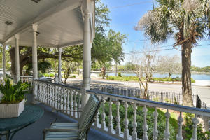 Spacious first floor piazza to take full advantage of Colonial Lake views and sunsets beyond .