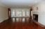 Gorgeous and Spacious Great Room with Fireplace and beautiful wide plank wood floors.