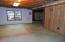 Unfinished basement space would be perfect for a media room!